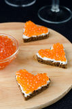 Three sandwich with red caviar in the form of a heart on a woode Royalty Free Stock Photography