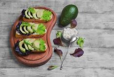 Three sandwiches with avocado Stock Photos