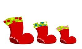 Three Santa boots Stock Photo