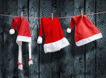 Three Santa Claus hat hanging on a clothesline Stock Images