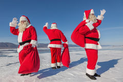 Three  Santa Claus outdoors Royalty Free Stock Image
