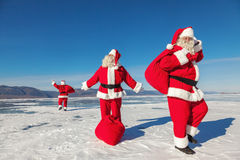 Three  Santa Claus outdoors Royalty Free Stock Photo