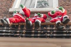 Three Santa dolls hanging on a balcony royalty free stock photos