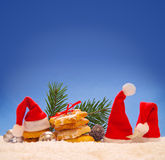 Three  Santa hat and Christmas cookies. Stock Images