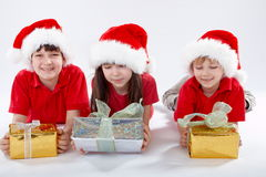 Three santa kids Stock Photo