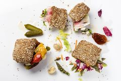 Three sanwiches with vegetables and pickles royalty free stock photography