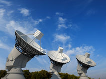 Three satellite dishes. With blue sky background Stock Image