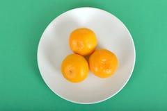Three Satsumas on a Plate Royalty Free Stock Photography