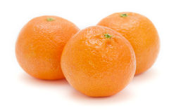 Three satsumas on white background Stock Photos