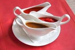 Three sauces - adjika, tkemali and satsebeli Royalty Free Stock Photos
