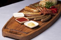 Three sauces with beef sausages, micro greens, food delivery royalty free stock photo