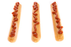 Three sausages with ketchup Stock Photography