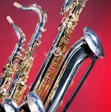 Three Saxophones on Red Royalty Free Stock Photo