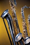 Three Saxophones on Yellow Stock Photography