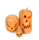 Three scary jack lanterns. Stock Photos