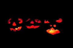 Three scary jack o'lantern faces Royalty Free Stock Photos