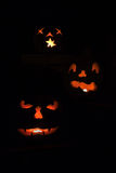 Three scary jack o'lanterns vertical Royalty Free Stock Images