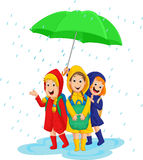 Three school girl with raincoat under a large umbrella on a rainy day. Vector illustration of three school girl with raincoat under a large umbrella on a rainy Royalty Free Stock Photos