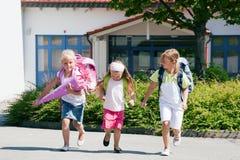 Three schoolchildren having fun royalty free stock photo