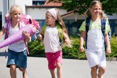 Three schoolchildren having fun stock photography