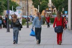 Three schoolgirls. Three girls walking on the street Stock Images