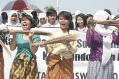 Three schoolgirls broom anti-corruption action Stock Photography
