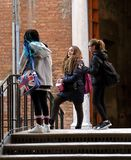 Three schoolgirls on the narrow street of Venice stock images