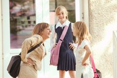 Three schoolgirls Stock Images