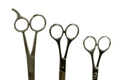Three scissors Stock Images