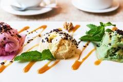 Three scoops of pistachio, strawberry and vanilla ice cream Royalty Free Stock Image