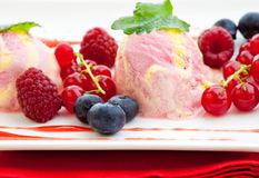Three scoops of raspberry ice cream with fruit Royalty Free Stock Photography