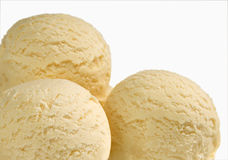Three scoops of vanilla ice cream Stock Image