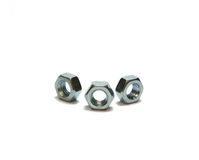 Three scre nuts. Isolated, white, close-up, semicircle Royalty Free Stock Photography