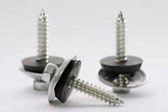 Three screws Stock Image
