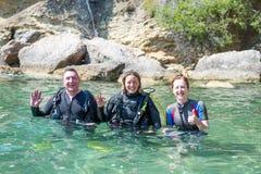 Three Scuba Divers stock photography