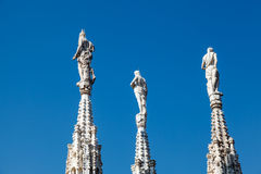 Three Sculptures on the Roof of Milan Cathedral Stock Image