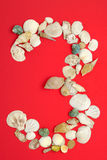 Three with sea shells. Number three arrange from sea shells stock image