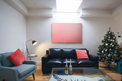 Three seater sofa in living room with christmas tree Royalty Free Stock Images