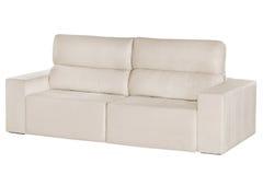 Three seats cozy beige sofa Stock Images