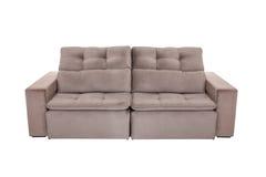 Three seats cozy brown sofa Stock Photos