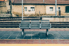 Three seats on railway station outdoor Stock Images