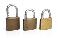 Three security gold locks Stock Photography