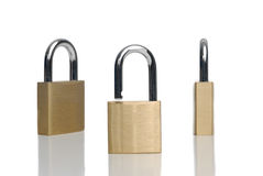 Three security gold locks Stock Image