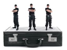 Triple security. Three security guys standing on black cipher suitcase shot on white, security concept Royalty Free Stock Photography