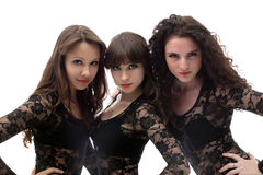 Three seductive young brunettes, close-up Royalty Free Stock Photo