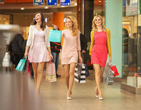 Three self-cofident friends on the shopping Stock Photo