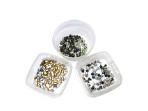 Three semi transparent containers with assorted computer screws Royalty Free Stock Image