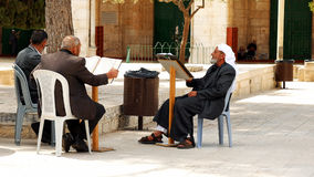 Three senior Muslims pray and read the Quran Royalty Free Stock Image