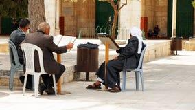 Three senior Muslims pray and read the Quran Stock Photos
