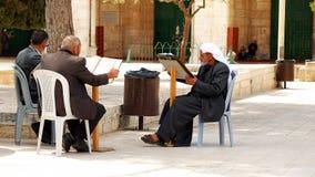 Three senior Muslims pray and read the Quran Royalty Free Stock Photos